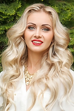 Ukrainian girl Viktoria,26 years old with green eyes and blonde hair.