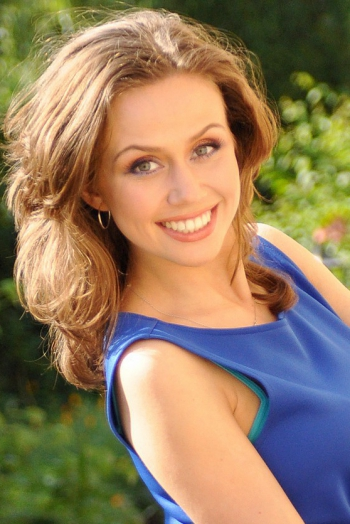 Ukrainian girl Ilona,29 years old with grey eyes and light brown hair.