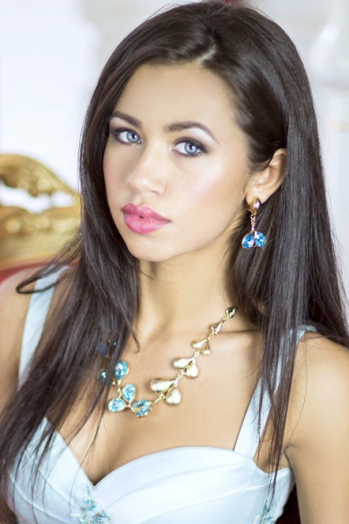 Ukrainian girl Daria,24 years old with blue eyes and black hair.