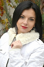 Ukrainian girl Tatiana,34 years old with blue eyes and black hair.