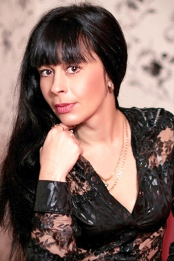 Ukrainian girl Irina,50 years old with brown eyes and black hair.
