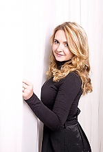 Ukrainian girl Anastasia,21 years old with brown eyes and light brown hair.