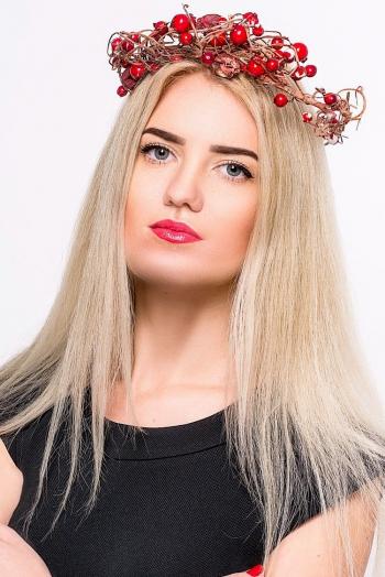 Ukrainian girl Olga,27 years old with green eyes and blonde hair.