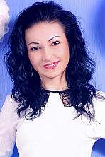 Ukrainian girl Yana,31 years old with hazel eyes and black hair.