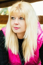 Russian girl Mariya,37 years old with green eyes and blonde hair.