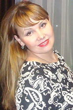 Ukrainian girl Julia,32 years old with grey eyes and blonde hair.