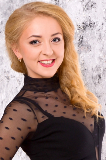Ukrainian girl Vita,26 years old with blue eyes and blonde hair.