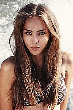 Ukrainian girl  Diana,22 years old with green eyes and light brown hair.
