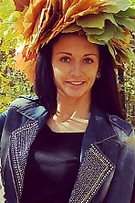 Ukrainian girl Catherine,27 years old with green eyes and black hair.