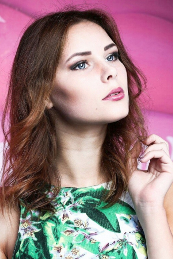 Ukrainian girl Anastasia,19 years old with blue eyes and light brown hair.
