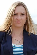 Ukrainian girl Tatiana,23 years old with green eyes and blonde hair.