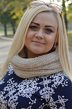 Ukrainian girl Anna,20 years old with green eyes and blonde hair.