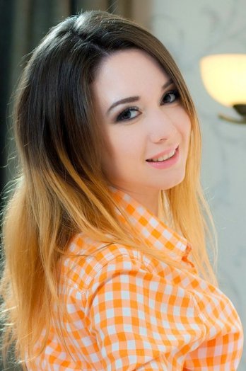 Ukrainian girl Julia,28 years old with brown eyes and light brown hair.