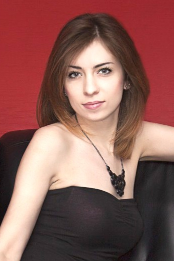 Ukrainian girl Asya,26 years old with green eyes and light brown hair.