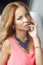 Ukrainian girl Viktoria,25 years old with grey eyes and red hair.