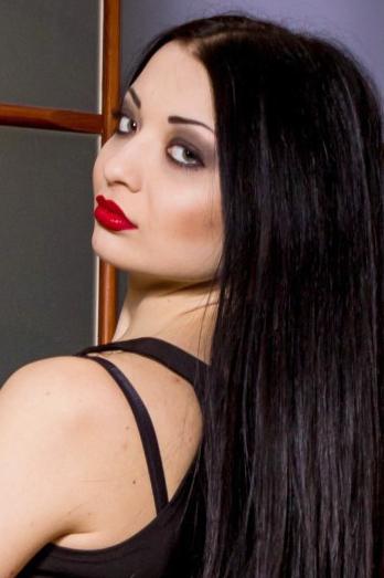 Ukrainian girl Anastasia,24 years old with green eyes and dark brown hair.