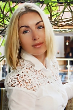 Ukrainian girl Olga,36 years old with grey eyes and blonde hair.