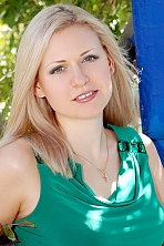 Russian girl Irina,35 years old with grey eyes and blonde hair.