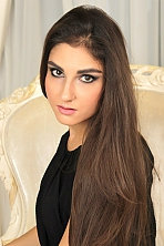 Ukrainian girl Lina,27 years old with brown eyes and dark brown hair.
