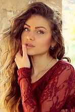 Ukrainian girl Alexandra,21 years old with brown eyes and light brown hair.