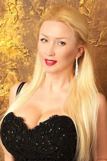 Ukrainian girl Lubov,41 years old with green eyes and blonde hair.