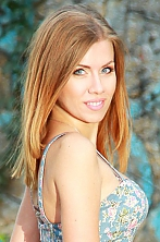 Ukrainian girl Marina,30 years old with blue eyes and light brown hair.