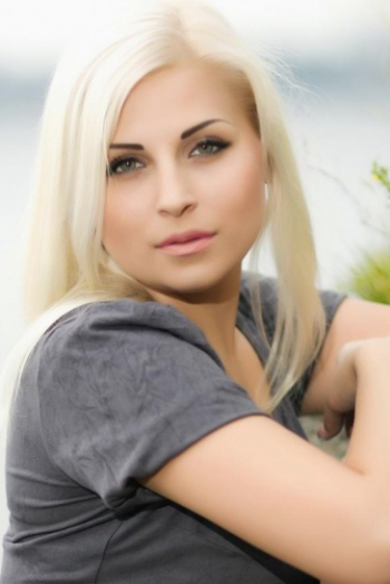 Ukrainian girl Ekaterina,29 years old with green eyes and blonde hair.