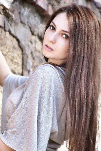 Ukrainian girl Ruslana,23 years old with grey eyes and light brown hair.