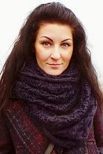 Ukrainian girl Svetlana,30 years old with blue eyes and black hair.