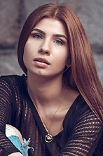 Ukrainian girl Anastasia,27 years old with green eyes and light brown hair.