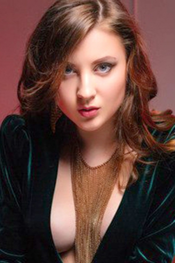 Ukrainian girl Natalia,22 years old with green eyes and light brown hair.