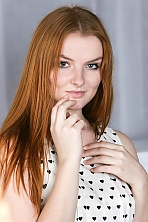 Ukrainian girl Victoria,21 years old with grey eyes and red hair.