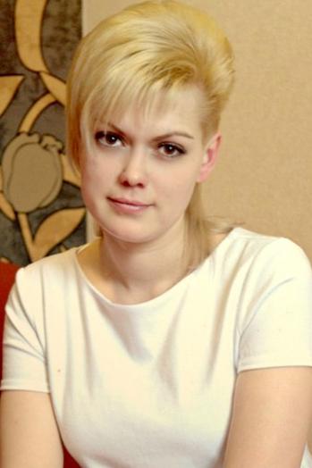 girl Katya , years old with  eyes and  hair.