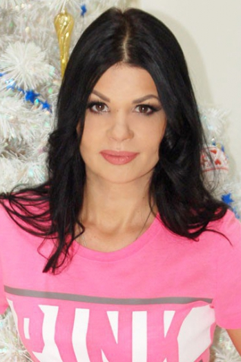 Ukrainian girl Irina,38 years old with brown eyes and black hair.