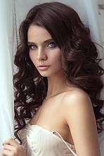 Russian girl Kristina,27 years old with blue eyes and dark brown hair.