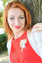 Ukrainian girl Nadejda,30 years old with green eyes and red hair.