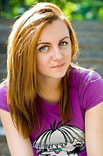 Ukrainian girl Kristina,24 years old with blue eyes and red hair.