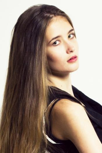 Ukrainian girl Maria,19 years old with brown eyes and dark brown hair.