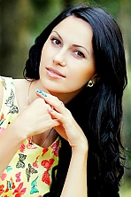 Ukrainian girl Oksana,27 years old with hazel eyes and dark brown hair.