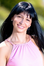 Ukrainian girl Tatiana,35 years old with hazel eyes and black hair.
