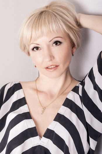 Ukrainian girl Yuliya,37 years old with blue eyes and blonde hair.