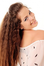 Ukrainian girl Alyona,27 years old with green eyes and dark brown hair.