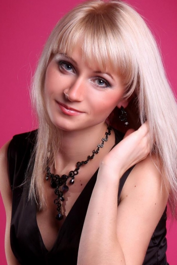 girl Natalya, years old with  eyes and  hair.