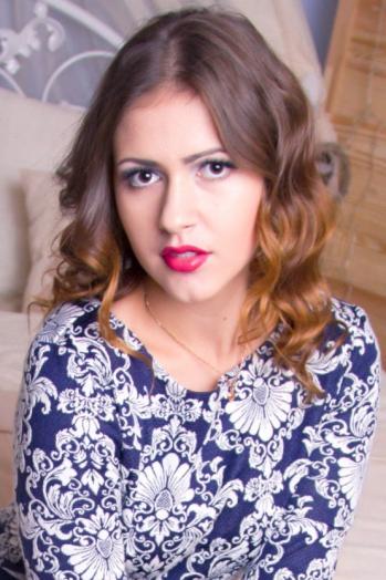 Ukrainian girl Anastasia,21 years old with brown eyes and light brown hair.