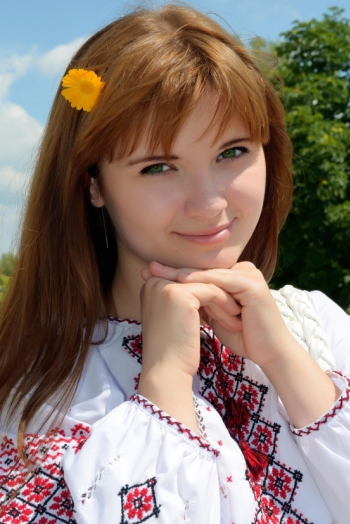 Ukrainian girl Olga,24 years old with green eyes and red hair.