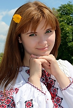 Ukrainian girl Olga,25 years old with green eyes and red hair.