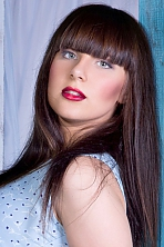 Ukrainian girl Juliya,20 years old with blue eyes and black hair.