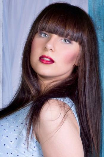 Ukrainian girl Juliya,20 years old with blue eyes and black hair.