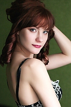 Ukrainian girl Olga,22 years old with blue eyes and auburn hair.