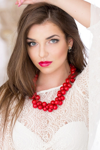 Ukrainian girl Olena,21 years old with blue eyes and dark brown hair.